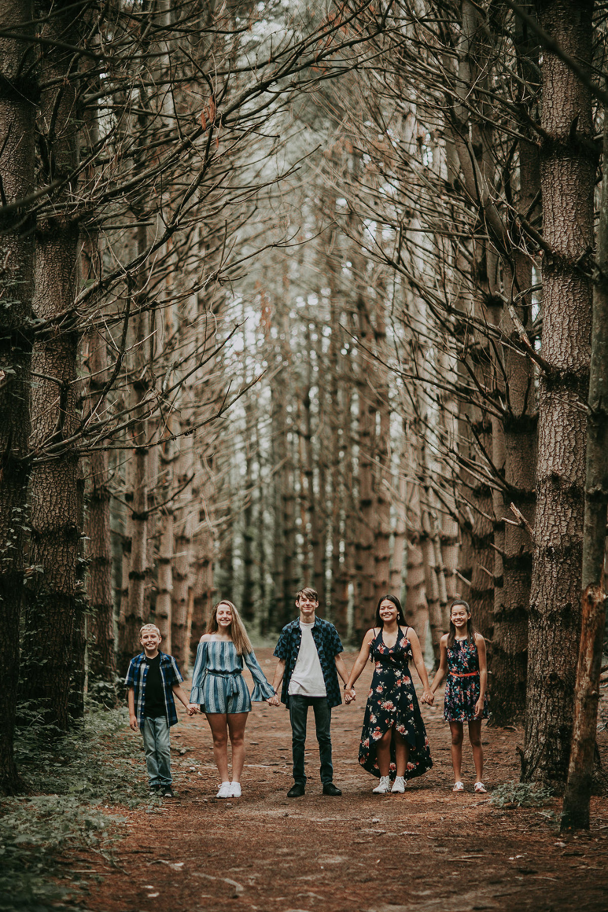 Kansas City Family photographer outdoor with trees in forest