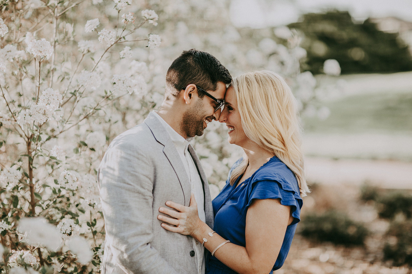 Kansas City Engagement photographer with spring blossoms